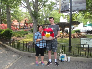 "Heaven and Justin holding ""Robin,"" their prize from one of the arcades."