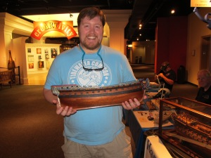 Al holding one of the ship models. This one took 1,000 hours to complete!