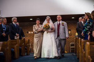 Walking down the aisle with Mom and Dad.