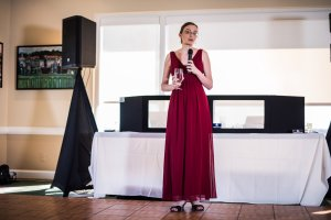 The beautiful maid of honor, Melissa, making her speech.